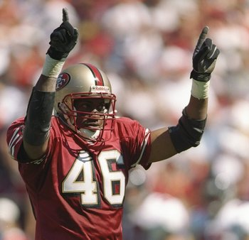 21 Sep 1997:  Defensive back Tim McDonald #46 of the San Francisco 49ers celebrates during the 49ers 34-7 win over the Atlanta Falcons at 3Com Park in San Francisco, California. Mandatory Credit: Todd Warshaw  /Allsport