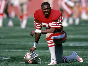 SAN FRANCISCO - OCTOBER 12:  Defensive back Eric Wright #21 of the San Francisco 49ers kneels on the field during a game against the Minnesota Vikings at Candlestick Park on October 12, 1986 in San Francisco, California.  The Minnesota Vikings won 27-24 i