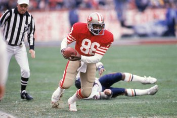 SAN FRANCISCO - JANUARY 6:  Wide receiver Freddie Solomon #88 of the San Francisco 49ers runs with the ball during the 1984 NFC Championship Game against the Chicago Bears at Candlestick Park on January 6, 1985 in San Francisco, California.  The 49ers won