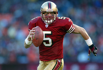 SAN FRANCISCO - DECEMBER 7:  Jeff Garcia #5 of the San Francisco 49ers runs for a touchdown against the Arizona Cardinals during an NFL game on December 7, 2003 at Candelstick Park in San Francisco, California.  (Photo by Jed Jacobsohn/Getty Images)