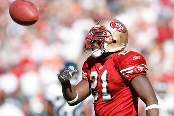 SAN FRANCISCO - OCTOBER 12:  Running back Frank Gore #21 of the San Francisco 49ers celebrates a 6-yard touchdown run against the Philadelphia Eagles during their game on October 12, 2008 at Candlestick Park in San Francisco, California. Philadelphia won