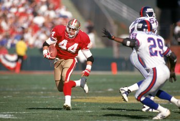 SAN FRANCISCO - JANUARY 15:  Full back Tom Rathman #44 of the San Francisco 49ers runs with the ball during the 1993 NFC Championship game against the New York Giants at Candlestick Park on January 15, 1994 in San Francisco, California.  The 49ers won 44-
