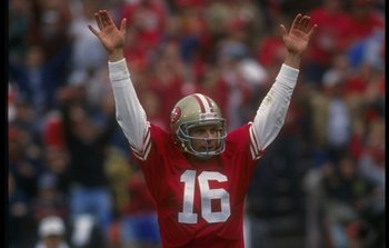 13 Jan 1991:  Quarterback Joe Montana #16 of the San Francisco 49ers raises his hands in celebration as he signals a touch down following a successful reception in the endzone during a play in the 49ers 28-10 victory over the Washington Redskins at Candls