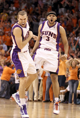 PHOENIX - MAY 25:  Jared Dudley #3 and Louis Amundson #17 of the Phoenix Suns celebrate after Dudley hit a 3 point shot against the Los Angeles Lakers in the fourth quarter of Game Four of the Western Conference finals of the 2010 NBA Playoffs at US Airwa