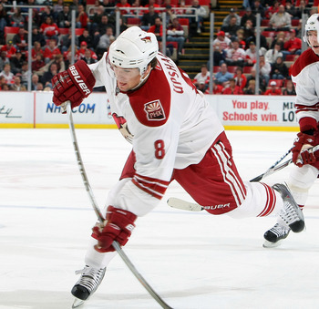 DETROIT - OCTOBER 28:  Scottie Upshall #8 of the Phoenix Coyotes takes a shot against the Detroit Red Wings during their NHL game at Joe Louis Arena on October 28, 2010 in Detroit, Michigan.(Photo By Dave Sandford/Getty Images)