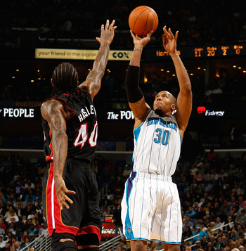 NEW ORLEANS - NOVEMBER 05:  David West #30 of the New Orleans Hornets shoots the ball over Udonis Halem #40 of the Miami Heat at the New Orleans Arena on November 5, 2010 in New Orleans, Louisiana.  The Hornets defeated the Heat 96-93.  NOTE TO USER: User