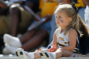 ATLANTA - OCTOBER 09:  A young fan of the Georgia Tech Yellow Jackets looks on before the game against the Virginia Cavaliers at Bobby Dodd Stadium on October 9, 2010 in Atlanta, Georgia.  (Photo by Kevin C. Cox/Getty Images)