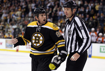 BOSTON - MAY 10:  Marc Savard #91 of the Boston Bruins reacts after he is called for a penalty in the third period against the Philadelphia Flyers in Game Five of the Eastern Conference Semifinals during the 2010 NHL Stanley Cup Playoffs at TD Garden on M
