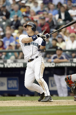 SEATTLE - JUNE 18:  Kenji Johjima #2 of the Seattle Mariners bats against the San Francisco Giants on June 18, 2006 at Safeco Field in Seattle, Washington. The Mariners defeated the Giants 5-1.  (Photo by Otto Greule Jr/Getty Images)