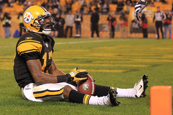 PITTSBURGH - NOVEMBER 14:  Mike Wallace #17 of the Pittsburgh Steelers celebrates scoring a touchdown against the New England Patriots on November 14, 2010 at Heinz Field in Pittsburgh, Pennsylvania.  (Photo by Chris McGrath/Getty Images)