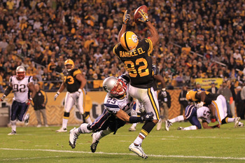 PITTSBURGH - NOVEMBER 14: Antwaan Randle El #82 of the Pittsburgh Steelers fumbles a catch in the endzone under pressure from Patrick Chung #25 of the New England Patriots on November 14, 2010 at Heinz Field in Pittsburgh, Pennsylvania.  (Photo by Chris M