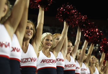 TUCSON, AZ - OCTOBER 23:  Arizona Wildcats cheerleaders peform during the college football game against the Washington Huskies at Arizona Stadium on October 23, 2010 in Tucson, Arizona.   The Wildcats defeated the Huskies 44-14.  (Photo by Christian Peter