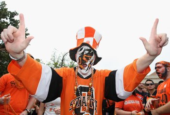 STILLWATER, OK - SEPTEMBER 05:  A fan of the Oklahoma State Cowboys cheers before the college football game against the Georgia Bulldogs at Boone Pickens Stadium on September 5, 2009 in Stillwater, Oklahoma.  The Cowboys defeated the Bulldogs 24-10.  (Pho