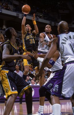 3 Dec 2000:  Reggie Miller #31 of the Indiana Pacers jumps to shoot the ball during the game against the Milwaukee Bucks at the Bradley Center in Milwaukee, Wisconsin. The Bucks defeated the Pacers 92-80.    NOTE TO USER: It is expressly understood that t