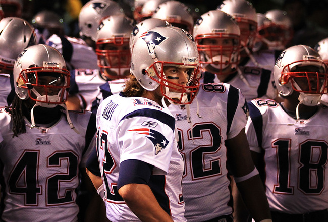 PITTSBURGH - NOVEMBER 14:  Tom Brady #12 of the New England Patriots waits in the tunnel to lead his team onto the field against the Pittsburgh Steelers on November 14, 2010 at Heinz Field in Pittsburgh, Pennsylvania.  (Photo by Chris McGrath/Getty Images