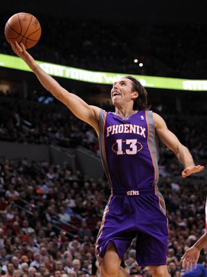 PORTLAND, OR - OCTOBER 26: Steve Nash #13 of the Phoenix Suns lays up the ball agianst the Portland Trail Blazers on October 26, 2010 at the Rose Garden in Portland, Oregon.  NOTE TO USER: User expressly acknowledges and agrees that, by downloading and or
