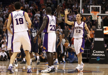 PHOENIX - NOVEMBER 05:  Steve Nash #13 of the Phoenix Suns high fives teammates during the NBA game against the Memphis Grizzlies at US Airways Center on November 5, 2010 in Phoenix, Arizona.  The Suns defeated the Grizzlies 123-118 in double overtime.  N