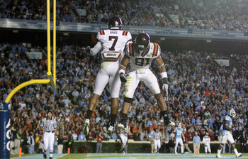 CHAPEL HILL, NC - NOVEMBER 13:  Marcus Davis #7 of the Virginia Tech Hokies celebrates after scoring a touchdown with teammate Jarrett Boykin #81 against the North Carolina Tar Heels during their game at Kenan Stadium on November 13, 2010 in Chapel Hill,