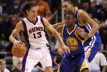 PHOENIX - OCTOBER 19:  Steve Nash #13 of the Phoenix Suns handles the ball during the preseason NBA game against the Golden State Warriors at US Airways Center on October 19, 2010 in Phoenix, Arizona. NOTE TO USER: User expressly acknowledges and agrees t
