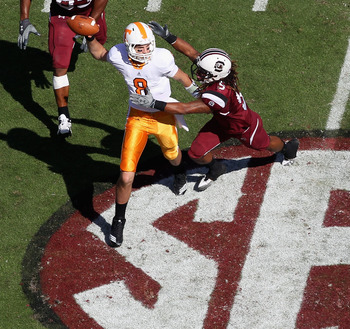 COLUMBIA, SC - OCTOBER 30:  Tyler Bray #8 of the Tennessee Volunteers chased by teammates Stephon Gilmore #5 and Cliff Matthews #83 of the South Carolina Gamecocks during their game at Williams-Brice Stadium on October 30, 2010 in Columbia, South Carolina