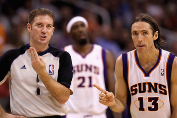 PHOENIX - OCTOBER 19:  Official Brent Barnaky #70 discuses a foul call with Steve Nash #13 of the Phoenix Suns during the preseason NBA game against the Golden State Warriors at US Airways Center on October 19, 2010 in Phoenix, Arizona. NOTE TO USER: User
