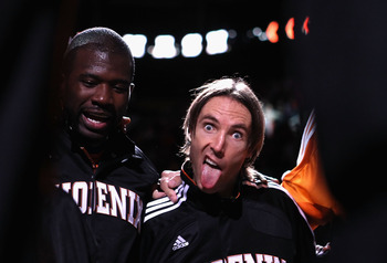 PHOENIX - OCTOBER 22:  Steve Nash #13 of the Phoenix Suns makes a funny face while huddled up with teammates before the preseason NBA game against the Denver Nuggets at US Airways Center on October 22, 2010 in Phoenix, Arizona. NOTE TO USER: User expressl