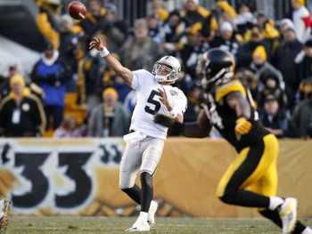 PITTSBURGH - DECEMBER 06:  Bruce Gradkowski #5 of the Oakland Raiders throws a fourth quarter pass while playing the Pittsburgh Steelers on December 6, 2009 at Heinz Field in Pittsburgh, Pennsylvania. Oakland won the game 27-24.  (Photo by Gregory Shamus/