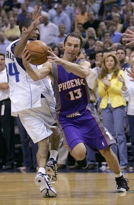 DALLAS - JUNE 01:  Steve Nash #13 of the Phoenix Suns drives past Devin Harris #34 of the Dallas Mavericks in game five of the Western Conference Finals during the 2006 NBA Playoffs on June 1, 2006 at American Airlines Center in Dallas, Texas.  NOTE TO US