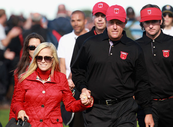 NEWPORT, WALES - OCTOBER 04:  Phil Mickelson of the USA walks with his wife Amy and teammates Matt Kuchar and Bubba Watson after the singles matches during the 2010 Ryder Cup at the Celtic Manor Resort on October 4, 2010 in Newport, Wales.  (Photo by Andr