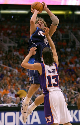 PHOENIX - MAY 28:  Dirk Nowitzki #41 of the Dallas Mavericks shoots over Steve Nash #13 of the Phoenix Suns in game three of the Western Conference Finals during the 2006 NBA Playoffs on May 28, 2006 at US Airways Center in Phoenix, Arizona.  The Maverick