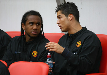 SUNDERLAND, UNITED KINGDOM - APRIL 11: Cristiano Ronaldo (R) of Manchester United chats with team mate Anderson as they sit on the bench prior to the Barclays Premier League match between Sunderland and Manchester United at The Stadium of Light on April 1