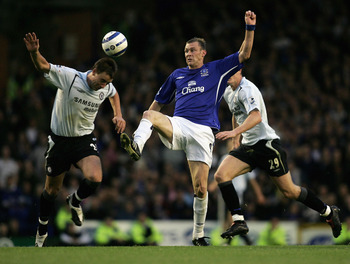 LIVERPOOL, ENGLAND  - OCTOBER 23:  John Terry of Chelsea clashes with Duncan Ferguson of Everton during the Barclay's Premiership match between Everton and Chelsea at Goodison Park on October 23, 2005, in Liverpool, England.  (Photo by Ben Radford/Getty I