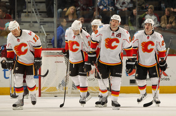DENVER - NOVEMBER 09:  (L-R) Olli Jokinen #13, Rene Bourque #17, Mark Giordano #5, Robyn Regehr #28 and Curtis Glencross #20 of the Calgary Flames skate toward the bench after scoring against the Colorado Avalanche at the Pepsi Center on November 9, 2010