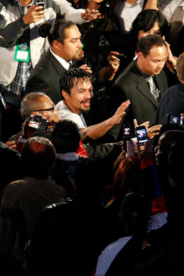 ARLINGTON, TX - NOVEMBER 13:  Manny Pacquiao (white trunks) of the Philippines celebrates as he leaves the ring after the won his bout against Antonio Margarito (black trunks) of Mexico during their WBC World Super Welterweight Title bout at Cowboys Stadi