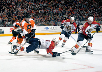 PHILADELPHIA - NOVEMBER 13:  Dmitry Kulikov #7 of the Florida Panthers tripped by Jeff Carter #17 of the Philadelphia Flyers on November 13, 2010 in Philadelphia, Pennsylvania. The Flyers went on to defeat the Panthers 5-2. (Photo by Lou Capozzola/Getty I