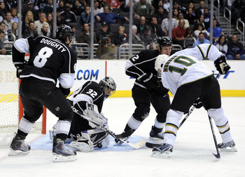 LOS ANGELES, CA - NOVEMBER 11:  Jonathan Quick #32 of the Los Angeles Kings makes a save as teammates Drew Doughty #8 and Matt Greene #2 look for a rebound along with Brenden Morrow #10 of the Dallas Stars at the Staples Center on November 11, 2010 in Los