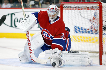 MONTREAL- NOVEMBER 13:  Carey Price #31 of the Montreal Canadiens makes a glove save on the puck during the NHL game against the Carolina Hurricanes at the Bell Centre on November 13, 2010 in Montreal, Quebec, Canada.  The Canadiens defeated the Hurricane