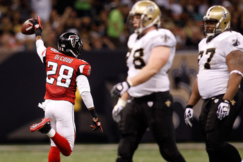 NEW ORLEANS - SEPTEMBER 26:  Thomas DeCoud #28 of the Atlanta Falcons celebrates after making an interception against the New Orleans Saints at the Louisiana Superdome on September 26, 2010 in New Orleans, Louisiana.  (Photo by Chris Graythen/Getty Images