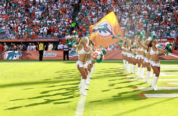 MIAMI - NOVEMBER 14:  Miami Dolphins cheerleaders are introduced against the Tennessee Titans at Sun Life Stadium on November 14, 2010 in Miami, Florida.  (Photo by Marc Serota/Getty Images)