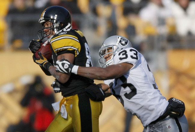 PITTSBURGH - DECEMBER 06:  Hines Ward #86 of the Pittsburgh Steelers catches a second quarter pass in front of Tyvon Branch #33 of the Oakland Raiders December 6, 2009 at Heinz Field in Pittsburgh, Pennsylvania. Oakland won the game 27-24.  (Photo by Greg