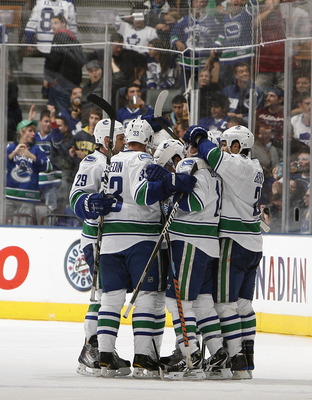 TORONTO - NOVEMBER 13:  The Vancouver Canucks celebrate Dan Hamhuis #2 goal during game action against the Toronto Maple Leafs at the Air Canada Centre November 13, 2010 in Toronto, Ontario, Canada. (Photo by Abelimages / Getty Images)
