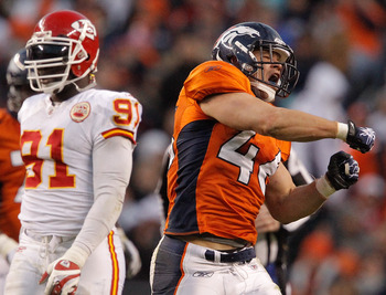 DENVER - NOVEMBER 14:  Full back Spencer Larsen #46 of the Denver Broncos celebrates a run for a first down as linebacker Tamba Hali #91 of the Kansas City Chiefs looks on during the third quarter at INVESCO Field at Mile High on November 14, 2010 in Denv