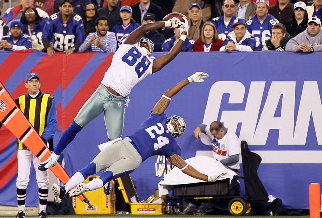 EAST RUTHERFORD, NJ - NOVEMBER 14:  Dez Bryant #88 of the Dallas Cowboys hauls in a first quarter touchdown reception against Terrell Thomas #24 of the New York Giants on November 14, 2010 at the New Meadowlands Stadium in East Rutherford, New Jersey.  (P
