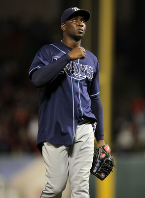 ARLINGTON, TX - OCTOBER 09:  Pitcher Rafael Soriano #29 of the Tampa Bay Rays reacts after a 6-3 win against the Texas Rangers during game 3 of the ALDS at Rangers Ballpark in Arlington on October 9, 2010 in Arlington, Texas.  (Photo by Ronald Martinez/Ge