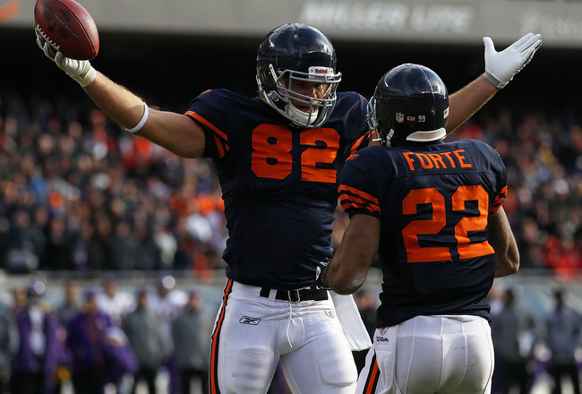 CHICAGO - NOVEMBER 14: Greg Olsen #82 of the Chicago Bears celebrates a touchdown catch with teammate Matt Forte #22 against the Minnesota Vikings at Soldier Field on November 14, 2010 in Chicago, Illinois.  The Bears defeated the Vikings 27-13. (Photo by
