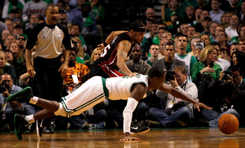 BOSTON, MA - OCTOBER 26: Eddie House #55 of the Miami Heat battles Rajon Rondo #9 of the Boston Celtics for a loose ball at the TD Banknorth Garden on October 26, 2010 in Boston, Massachusetts. NOTE TO USER: User expressly acknowledges and agrees that, by