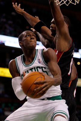 BOSTON, MA - OCTOBER 26: Rajon Rondo #9 of the Boston Celtics beats Chris Bosh #1 of the Miami Heatto the basket at the TD Banknorth Garden on October 26, 2010 in Boston, Massachusetts. NOTE TO USER: User expressly acknowledges and agrees that, by downloa