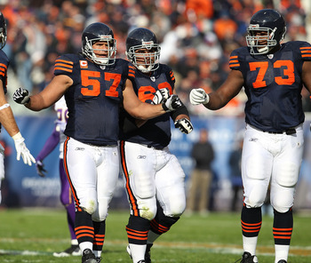CHICAGO - NOVEMBER 14: (L-R) Olin Kreutz #57, Roberto Garza #63 and J'Marcus Webb #73 of the Chicago Bears celebrate an offensive gain against the Minnesota Vikings at Soldier Field on November 14, 2010 in Chicago, Illinois. The Bears defeated the Vikings