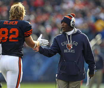 CHICAGO - NOVEMBER 14: Head coach Lovie Smith of the Chicago Bears congratulates Greg Olsen #82 after Olsen's touchdown catch against the Minnesota Vikings at Soldier Field on November 14, 2010 in Chicago, Illinois. The Bears defeated the Vikings 27-13. (