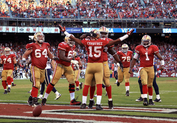 SAN FRANCISCO - NOVEMBER 14:  Michael Crabtree #15 of the San Francisco 49ers is congratulated by teammates after scoring a touchdown against the St. Louis Rams at Candlestick Park on November 14, 2010 in San Francisco, California.  (Photo by Ezra Shaw/Ge